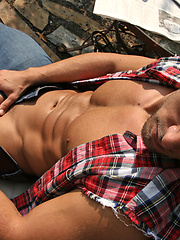 Muscled stud Cody jerking off dick